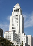 View of the LA City Hall skyscraper under a blue sky