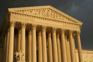Front of U.S. Supreme Court building with dramatic lighting
