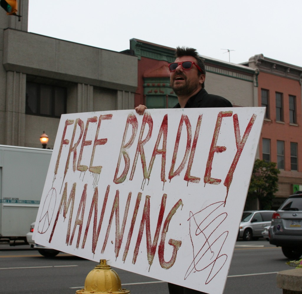 "Protestor holds sign reading ""FREE BRADLEY MANNING"" (Photo: EEJ)"